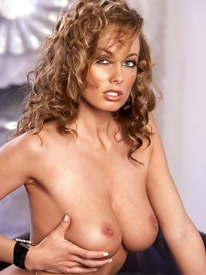Anita Dark takes off her polka-dot top and black undies to enjoy playing with her perfect naked breasts and pussy on a black leather loveseat all day